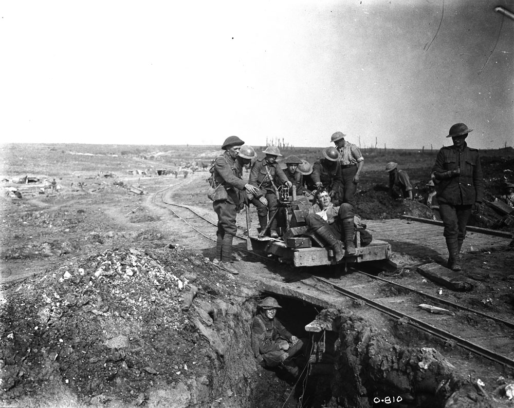Bringing in a wounded Canadian from the Battle of Courcelette, Sept. 1916. Photo: Library and Archives Canada | PA-000664