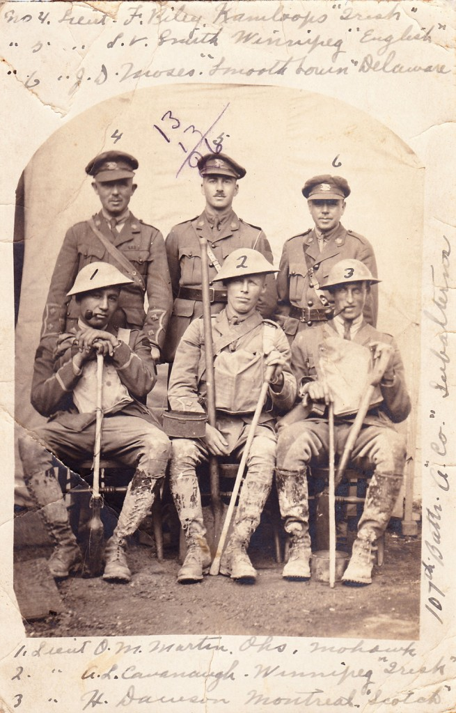 "Then-Lieutenant Martin, (sitting on left) posing with fellow oficers of the 107th Battalion (Winnipeg), July 1916. Note the knee-high mud on their boots - Martin spent 7 months in France & Belgium. Photo sourced from: ""Canada's Great War Album"" Project, Canada's History."