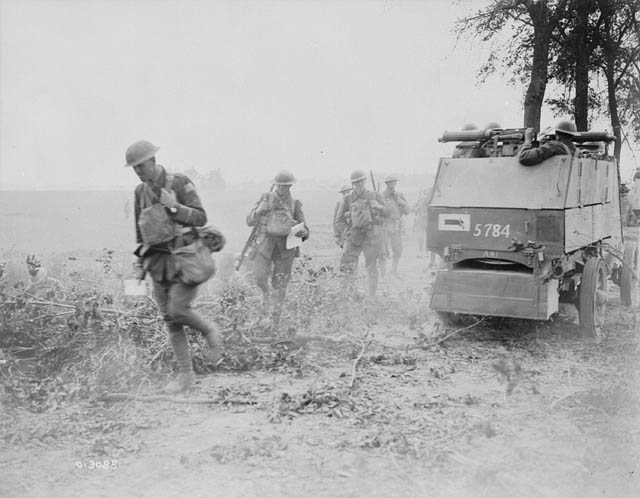 An armoured car (of the 1st or 2nd Canadian Motor Machine Gun Brigades) operating as part of Brig.-Gen. Raymond Brutinel's Canadian Independent Force, during an advance east of Amiens, 8 August 1918. Library and Archives Canada.