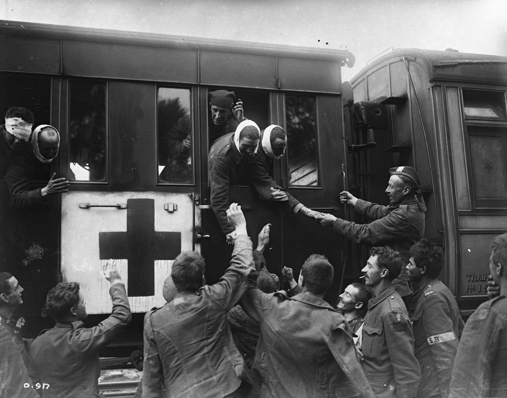 Wounded Troops Leaving For Blighty Are Sent Off By Their Healthier Comrades Those Who Received A Wound Were Generally Envied They Left
